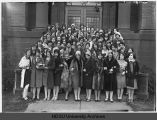 Female sorority pledges in front of Putnam Hall, North Dakota Agricultural College