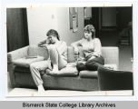 Two Bismarck Junior College students relaxing, Bismarck, N.D.