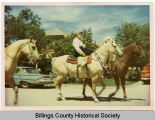 Mary Gilham riding in parade in Medora, N.D.