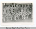 Bathing beauties at Bismarck Junior college model fashions of 1957