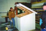 Agriculture student with two-story dog house