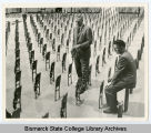 Installation of the seats in the Sidney J. Lee Auditorium at Bismarck Junior College, Bismarck,...