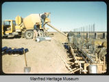 Pouring concrete base of west abutment, New Jim River Bridge, NW Manfred, ND, Hi-way 52, Nov 9, 1961