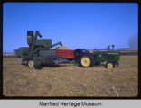 4010 tractor and combine at the Burkum farm, Manfred, N.D.
