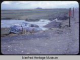 Car in ditch after flash flood South of Velva, N.D.