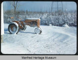 Allis Chalmers tractor north of house snow in April here