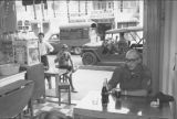 Staff Sgt. Richard J. Rogers in a Saigon sidewalk cafe