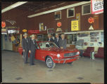 Red Ford Mustang in McGuire's show room, Rugby, N.D.