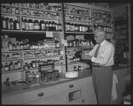 Fred Baillie in Baillie's Drug store, Rugby, N.D.