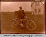 Emil Hanson with motorcycle, Squires, N.D.
