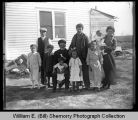 Family outside home, Northwest Williston, N.D.