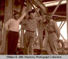 "Oil men R.L. ""Dick"" Rambo, W.A. ""Buck"" Garret and A.D. ""Blackie"" Davidson at the Bakken well, Tioga,"