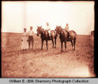 Couple and children on horses, Williston, N.D.