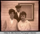 Young women and man outside house, Williston, N.D.