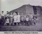Teacher and students of School 3, District 37 of Williams County stand outside sod schoolhouse near Zahl,
