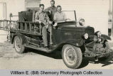 Firemen Johnny Laqua, Marshall Simpson, Francis Cannon, in 1929 Chevrolet Rural Fire Truck, North...