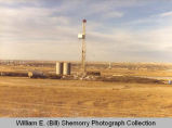 Lee oil well drilling rig, overlooking Williston, N.D.