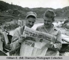 William E. (Bill) Shemorry and 1st Lieut. John Sanders read the Fargo Forum while in China