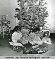 Gayle and Jan Shemorry with their Christmas presents, Williston, N.D.