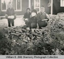 Children with ice blocks, Williston, N.D.