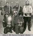 Snowmobile racers with trophies, Williston, N.D.