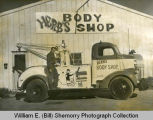 Herb's Body Shop truck and employee, Williston, N.D.