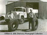 Westland Oil Company employees with tires, Williston, N.D.
