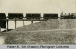 Wild Cow Railroad, carloads of dirt being dumped in fill for railroad construction, Watford City,...
