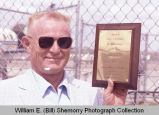 Sloulin Field International Airport rededication and air show, Jack E. Daniels with award, N.D.