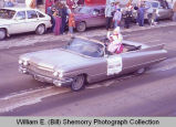 Williston Christmas parade 1983, Angela Huwe in automobile, N.D.