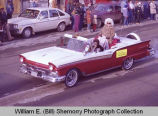 Williston Christmas parade 1983, Lou Hapip in automobile, N.D.