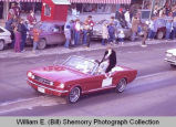 Williston Christmas parade 1983, woman in automobile, N.D.