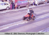 Williston Christmas parade 1983, Ray Atol on four-wheeler, N.D.
