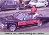 Williston Christmas parade 1983, Tom Villard in automobile, N.D.