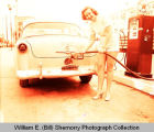North Star Filling station adverstisement, woman fills car with gas, N.D.