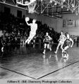 Williston Coyotes versus Mandan Braves, boys high school basketball game, Williston, N.D.