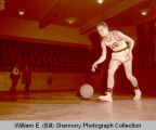 Basketball player in old Williston High School gymnasium, N.D.