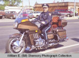 Band Day parade 1989, Police Chief Ray Atol on motorcycle, Williston, N.D.