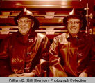 Ed Haakenson and Clarence Olness in Williston Fire Department station, N.D.
