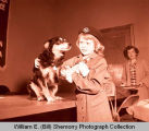 Girl Scout with dog, Williston, N.D.