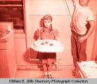 Girl Scout with Congratulations cake, Williston, N.D.