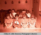 Girl Scouts praying in church, Williston, N.D.