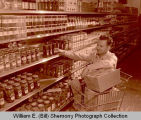 Kalil employee in store, Williston, N.D.