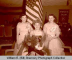 Military Ball Queen and princesses at Kiwanis Club in Plainsman Hotel, Williston, N.D.