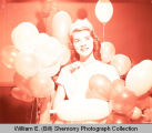 Pageant queen with balloons, Williston, N.D.