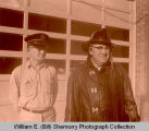 Melvin Knutson and Heinie Vohs outside the Williston Fire Department station, Williston, N.D.