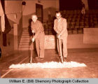 Sweeping up after basketball game in old Williston High School gymnasium, N.D.