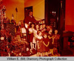 Salvation Army at Christmas, Captain Elcomb with guitar, Williston, N.D.