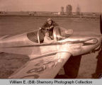 Tom Davidson and Ad Nordmaster in airplane, Williston, N.D.
