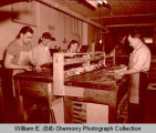 Williams County Farmers Press personnel in old Williston Press-Graphic building, Williston, N.D.